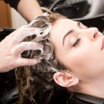 woman washing her hair in hairsalon